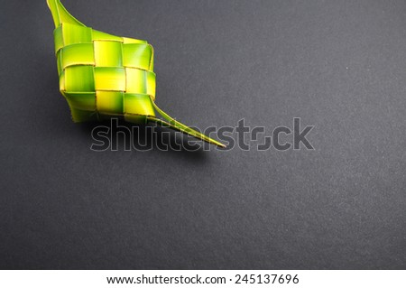 Ketupats, a natural rice casing made from young coconut leaves for cooking rice on white background  - stock photo