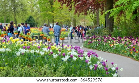 KEUKENHOF - LISSE ;Tourists at the Keukenhof on 8 may 2015.The Keukenhof is also known as the Garden of Europe,and is one of the world's largest flower gardens.Its situated in Lisse, the Netherlands. - stock photo