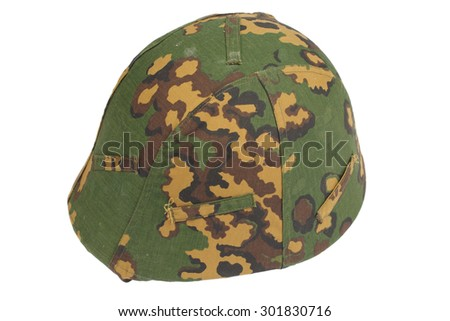kevlar helmet with a camouflage cover