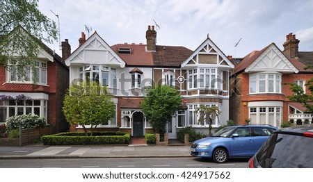 KEW, LONDON - MAY 7, 2016. A street of typical early twentieth century, English Edwardian period, townhouses at Kew in the Borough of Richmond, south west London, UK.