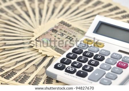 key and calculator - stock photo