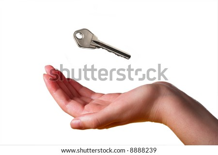 Key and hand - stock photo