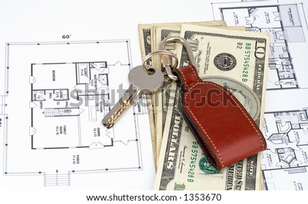 Key and money on home plan background