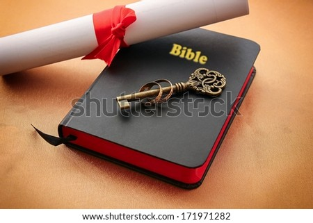 Key and rings on bible with document.