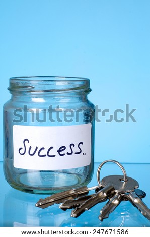 Key and the success jar: The concept of 'Key of success' - stock photo