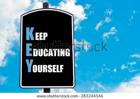 KEY as KEEP EDUCATING YOURSELF  motivational quote written on road sign isolated over clear blue sky background with available copy space. Concept  image - stock photo