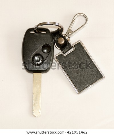 Key-chain Remote Control on white background - stock photo