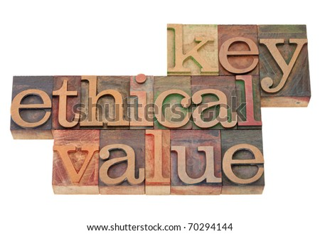 key ethical value - business term in vintage wooden letterpress printing blocks, stained by color inks, isolated on white