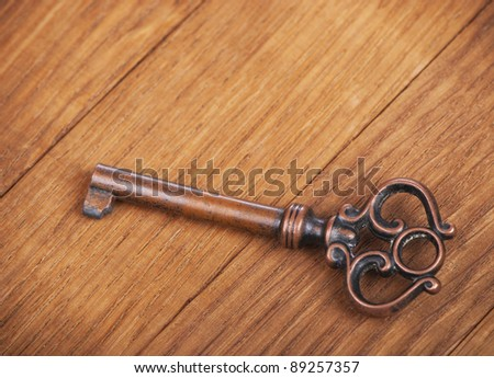 Key from an old case on a wooden surface