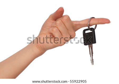 key from big house in the woman's hand - stock photo