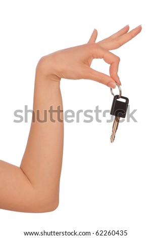 Key from the new house in hands of the woman - stock photo