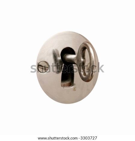 key in a lock - stock photo