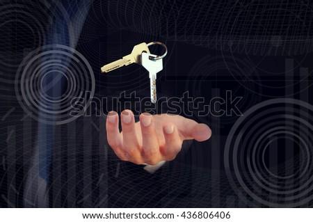 key in hand businessman - stock photo