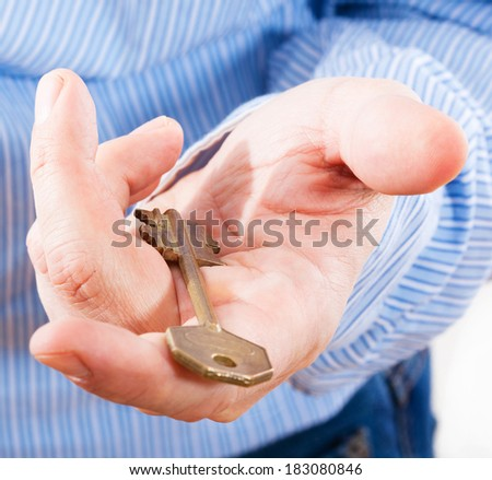 Key in hand businessman. Concept of buying real estate, new home - stock photo