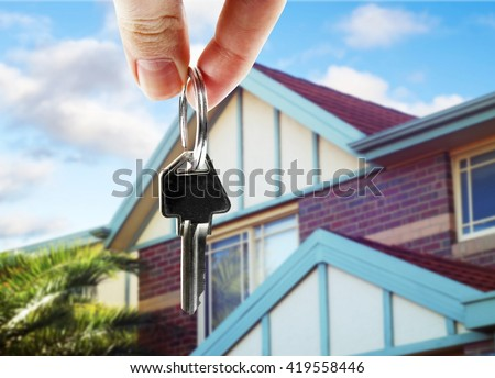key in hand with real estate - stock photo
