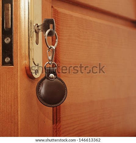 key in keyhole with blank tag  - stock photo
