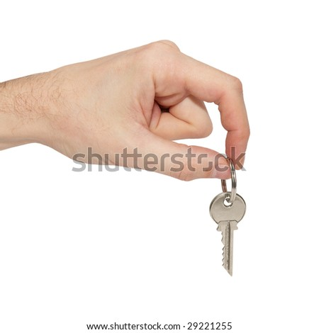 Key in the hand isolated on white