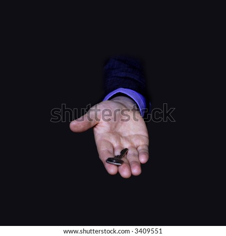 Key in the hand of a businessman, on black background - stock photo