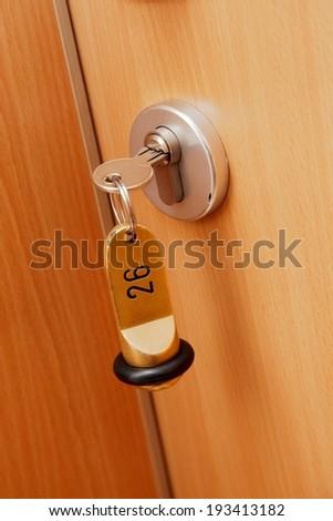 Key in the lock of a door - stock photo