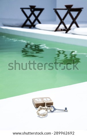 Key in the pool, close up - stock photo