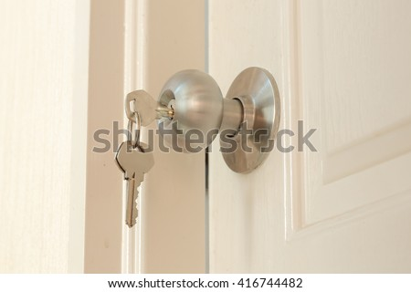 Key insert and hold in stainless steel round ball door knob - stock photo
