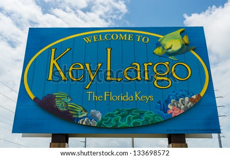 KEY LARGO, FL - CIRCA 2012: Welcome sign over the US1 in Key Largo circa 2012. The Florida Keys are a very popular tourist destination with over 2 million yearly visitors. - stock photo