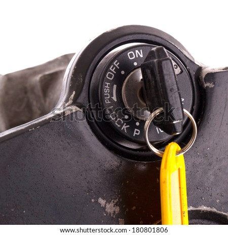 Key of an old motorcycle, selective focus, isolated - stock photo