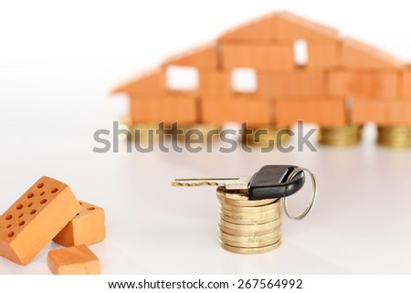 key on a stack of money coins - stock photo