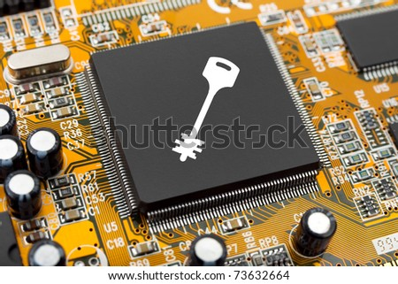 Key on computer chip - technology security concept - stock photo