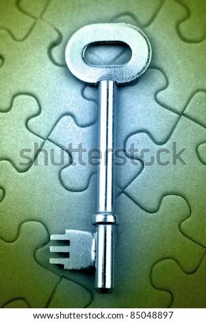 Key on jigsaw puzzle pieces - stock photo