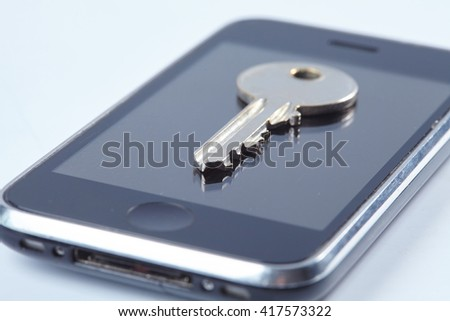 key on the mobile phone - stock photo