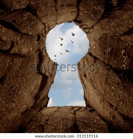 Key opening concept and the secret of success symbol as a mountain ciff shaped as a keyhole with birds flying away as a business or life metaphor for unlocking and access faith belief and religion. - stock photo