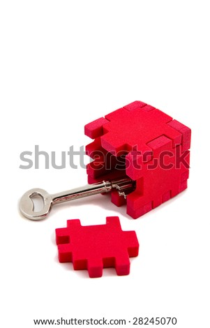 Key opens up a puzzle, isolated on white background. Vertical orientation - stock photo
