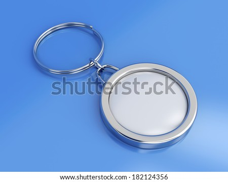 Key ring with space for text on blue background - stock photo