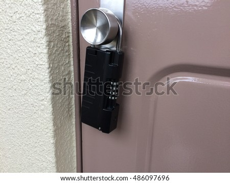 key  safety casing locked to door knob, user need to unlock the casing to get key to open the brown door.