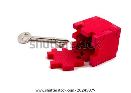 Key solves puzzle, isolated on white background - stock photo