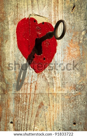 Key to heart symbol of love - stock photo