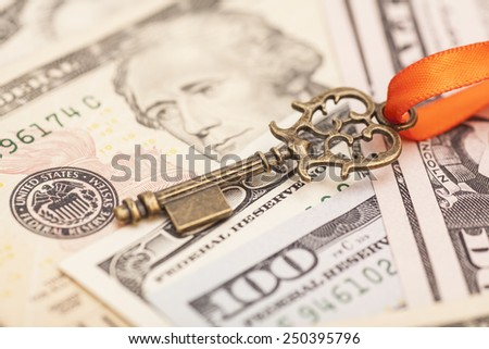 Key to success on different dollar banknotes  - stock photo