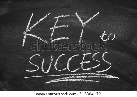 Key to Success on the blackboard with chalk writing.