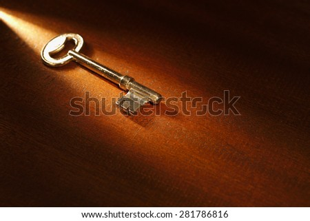 Key to success. Shot with a warm tungsten light streaming across image. - stock photo
