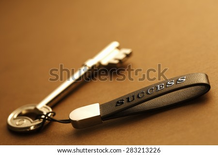 Key to success with the Success writing Leather label at  table - stock photo