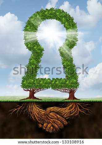 Key to team success and working together as a creative partnership to achieve a common solution with two trees shaped as a key hole with a glowing sun. - stock photo
