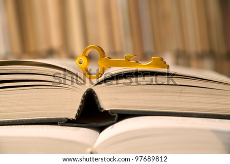 key to the book on the bookshelf background - stock photo