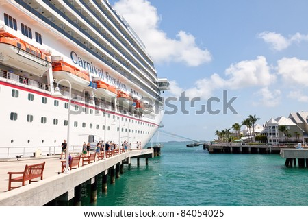 KEY WEST, FL - JULY 11: Carnival Freedom arrives in Key West, FL on July 11, 2011. Over 660,000 cruise ship passengers visit Key West every year to enjoy galleries, shops, and famous bar and grills. - stock photo