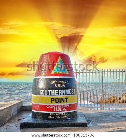Key West, Florida Buoy sign marking the southernmost point on the continental USA and distance to Cuba. Sunset view. - stock photo