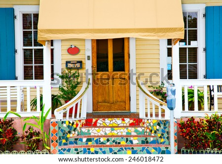 KEY WEST, FLORIDA - MARCH 23, 2009:  This cottage in Key West, Florida is indicative of the colorful style of this town, - stock photo