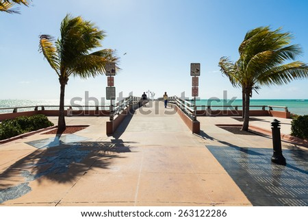Key West, Florida USA - March 3, 2015: Entrance to the White Street Pier in Key West with the Aids Memorial to the right. - stock photo