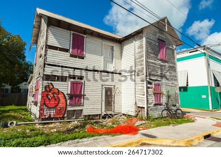 Key West, Florida USA - March 2, 2015: Typical unrestored wood frame architecture style home in the Bahama Village District of Key West.