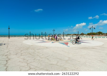 Key West, Florida USA - March 3, 2015: White Street Pier in Key West, Florida with visitors on bicycles. - stock photo