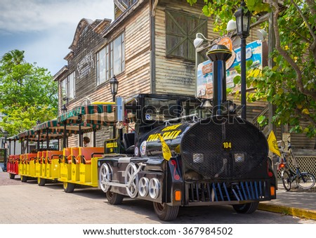 KEY WEST, FLORIDA USA - 2 MAY 2015 - The Conch Tour Train. The Conch Tour Train is a Popular Tourist Attraction Taking Visitors on Tours around Downtown Key West - stock photo